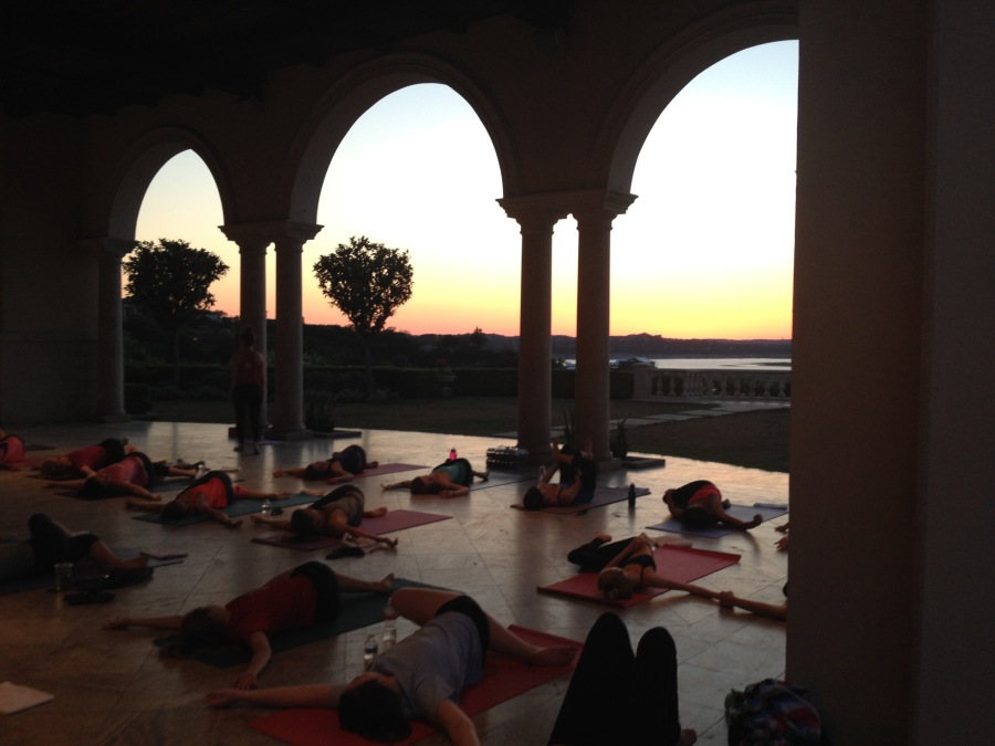 Baja Surf Yoga sunset class in supine twist overlooking Lake Travis