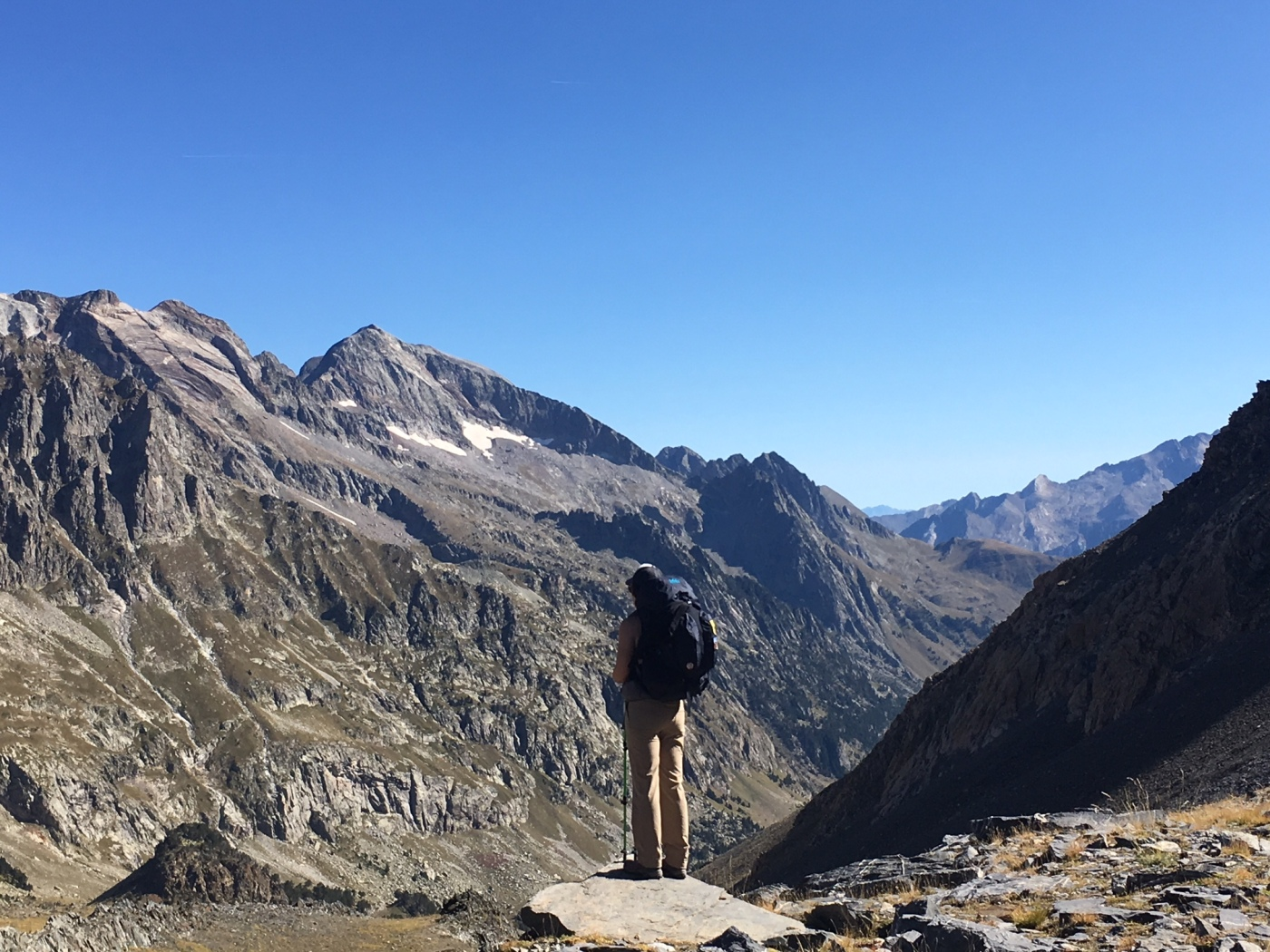 female hiker looks at mountains